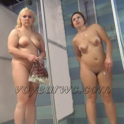 A hidden camera in a public shower films gorgeous women while they soap up their bodies (Hidden Camera Public Shower 117-129)
