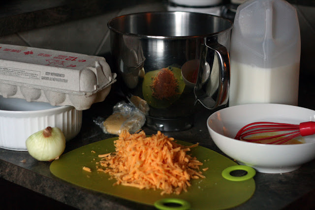 ingredients for making cheese souffle: eggs, onions, cheese, milk,