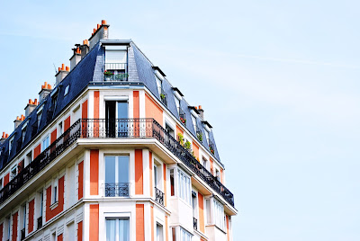 the top of a parisian style apartment building