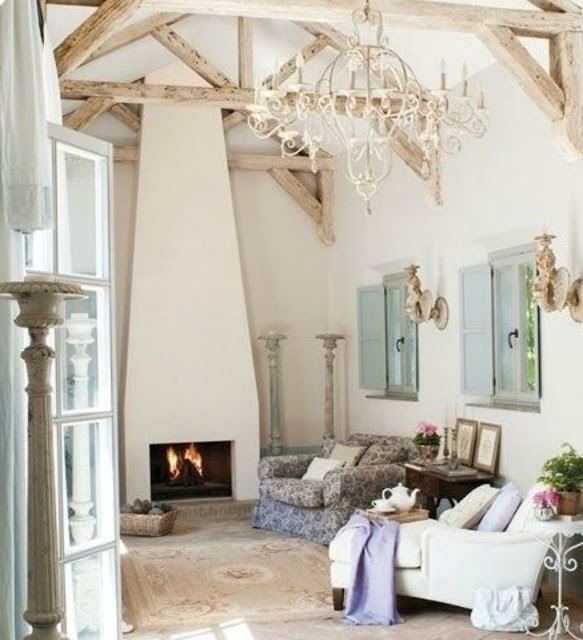 Breathtaking French farmhouse room with exposed rafters and pastels on Hello Lovely Studio