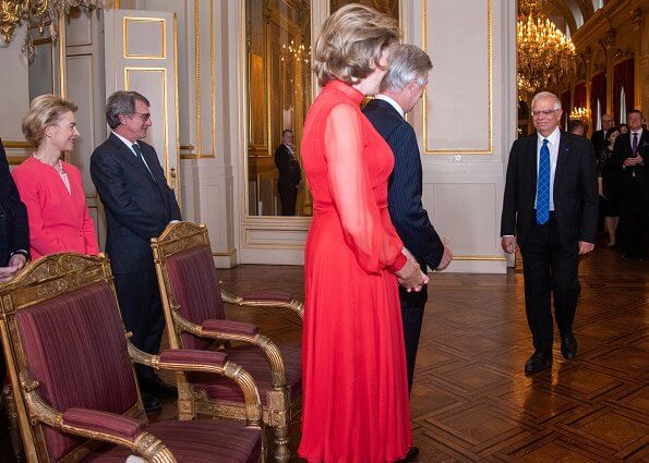 Dior red silk long dress. Christian Dior Show at Paris Fashion Week. Ursula von der Leyen, President of the European Commission