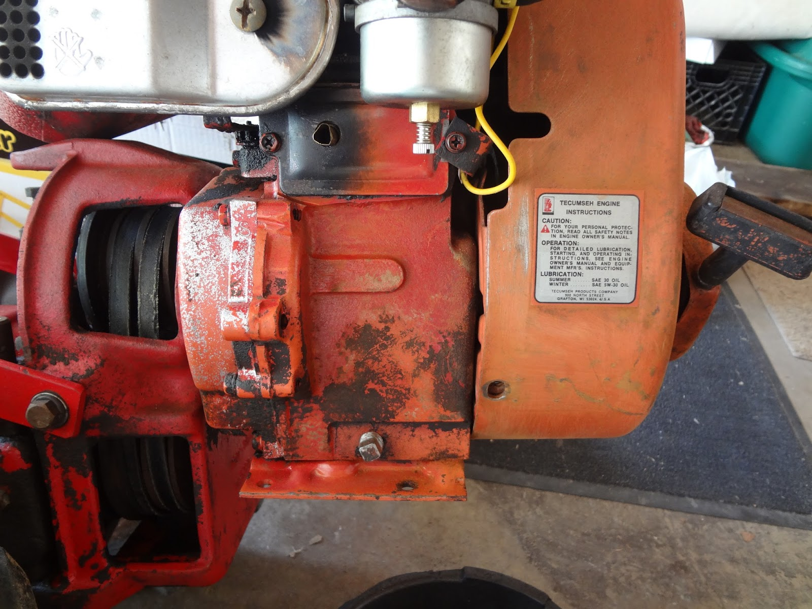 The somewhat orange, somewhat red Tecumseh HH60 engine. It didn't match!
