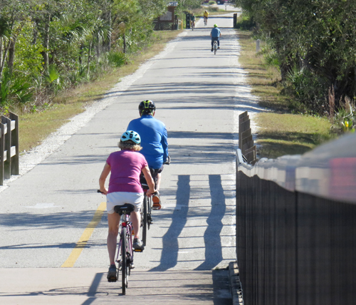 Two older bicyclsts on bicycle trail in Venice Florida