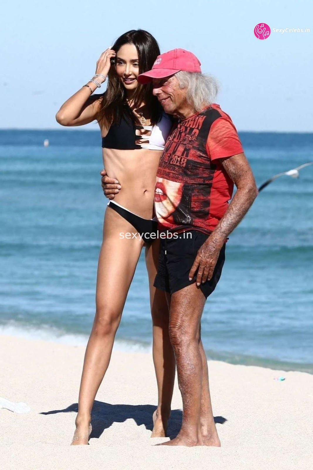 Patricia Contreras in tiny wet black bikini Beach Side