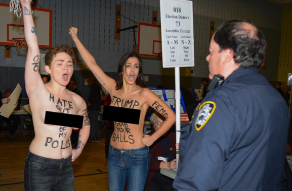 Two topless women protesting against Donald Trump's victory arrested by police (photos)