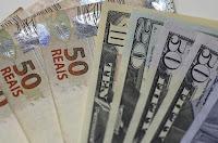 Às 12h20, a moeda norte-americana subia 1,74%, negociada a R$ 4,1644 na venda.
