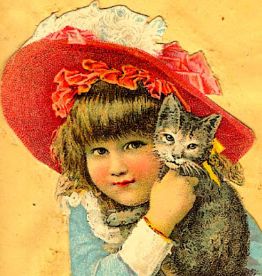 blond girl with large red & white bonnet cuddles gray kitten with white markings on face