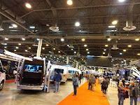 People looking at motorhomes at RV show