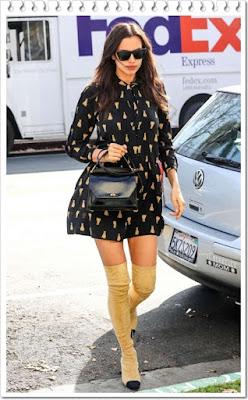 イリーナ・シェイク(Irina Shayk)は、ジバンシィ(Givenchy)のサングラスとトートバッグ、そして、シーニューヨーク (Sea New York)のワンピース、シャネル(Channel)のサイハイブーツを着用。