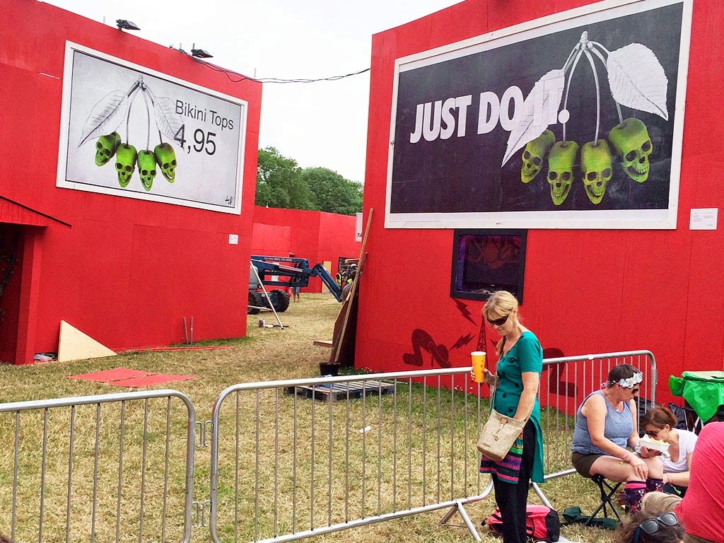 """While you were reading about Banksy's """"Sirens of The Lambs"""" installation @ Glastonbury, Ludo was at the festival site as well, working on his fake billboard ads."""