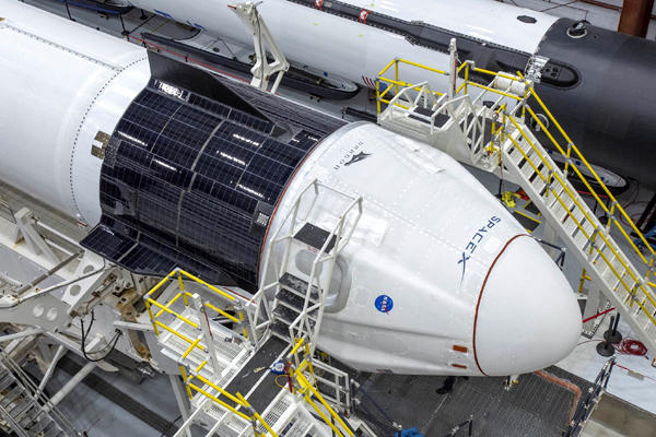 The Crew Dragon Demo-2 capsule is attached to its Falcon 9 rocket inside SpaceX's Horizontal Integration Facility...on May 20, 2020.