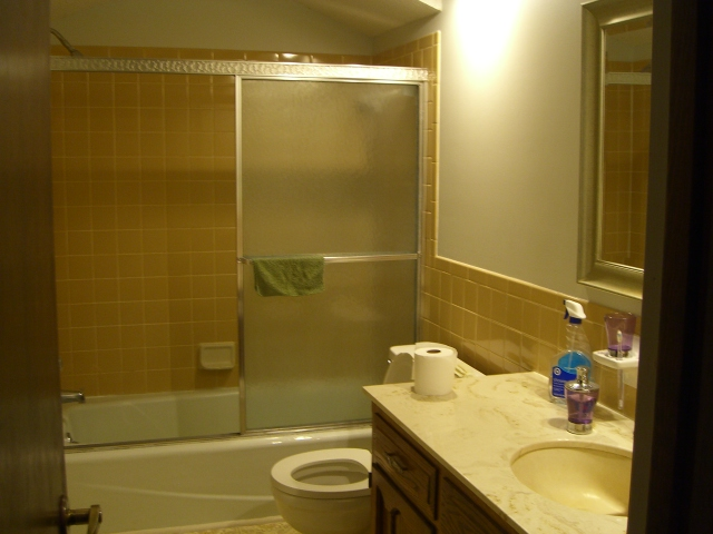 Remodelaholic Bathroom Makeover Yellow Gray Color Scheme - 70s bathroom remodel