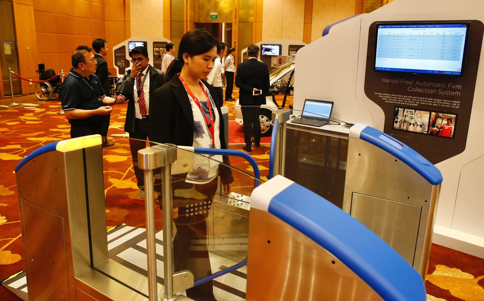 A delegate walking through a mock-up of a hands-free automatic fare collection system gantry on display at the Future of Transport showcase on Thursday (Oct 12), held in conjunction with this year's Asean Transport Ministers' Meeting.