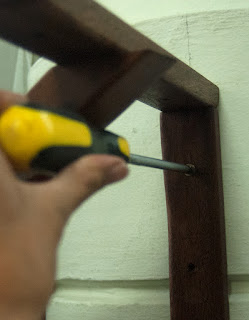 Screwing in brackets to wall