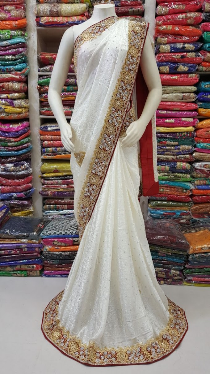 bridal white marun panetar style saree by sharmili.in all over multy border