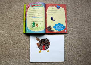 Tessa's completed work from pages 24-25 of the girls' book. The red robin picture is from the drawing lesson mentioned in the Closing Ceremony section below.