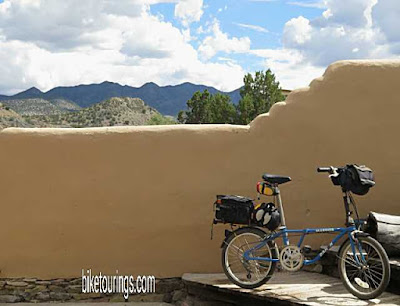 Picture of Dahon Folding bike with overnight bikepacking kit for travel photos.