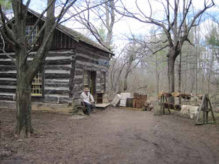 A Man Sits Outside ATrading Post At Westfiled Heritage Museum.
