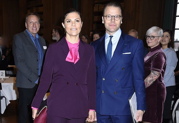 Crown Princess Victoria wears Caroline Svedbom Jewelry Drop Earring, and carried & Other Stories Scuba Clutch