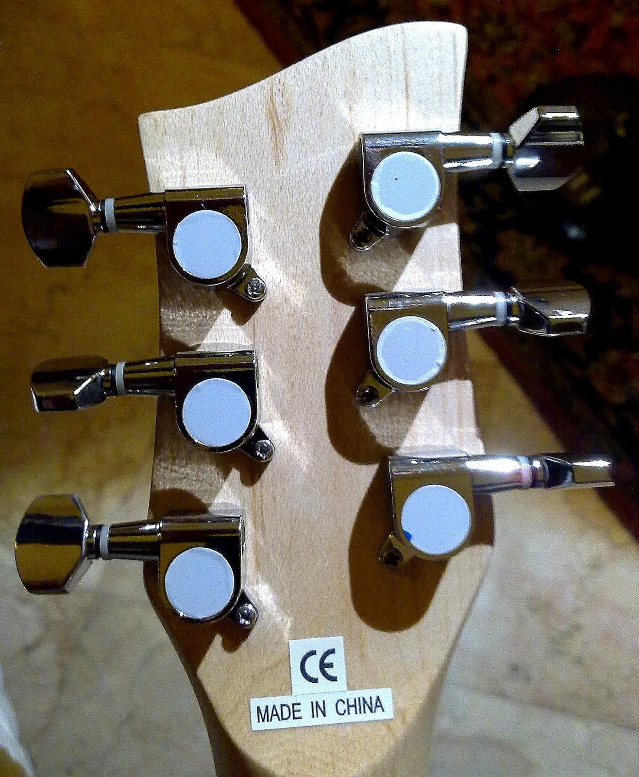 small resolution of at the head stock i unscrewed the hexagonal top nut of one tuner and found its centre post wiggling merrily after unscrewing one phillips screw from the