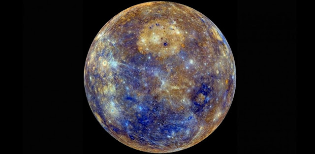Enhanced color image of Mercury. The bright, circular deposit in the upper center of the image is an enormous effusive volcanic deposit, situated within the largest impact crater on the planet, the Caloris basin. Image credit: NASA/JHU APL/CIW