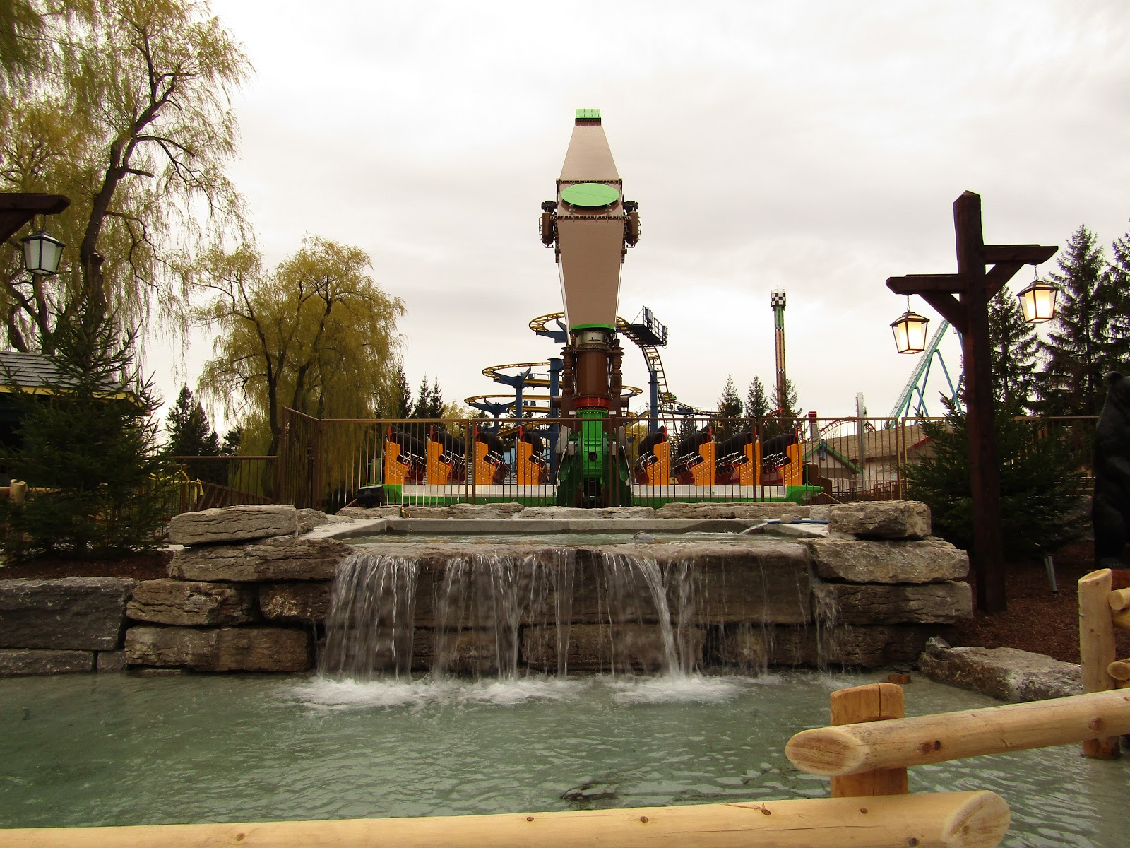 The all-new for 2017 Soaring Timbers. Here you can see the spectacular waterfall feature in front of the ride. Soaring Timbers painted brown and green and has yellow seats.
