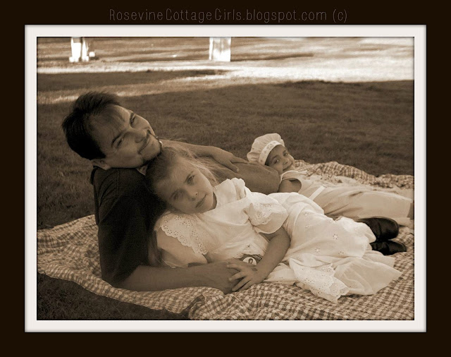 Photo of man with daughters on a picnic blanket on grass | rosevinecottagegirls.com  Things you should know