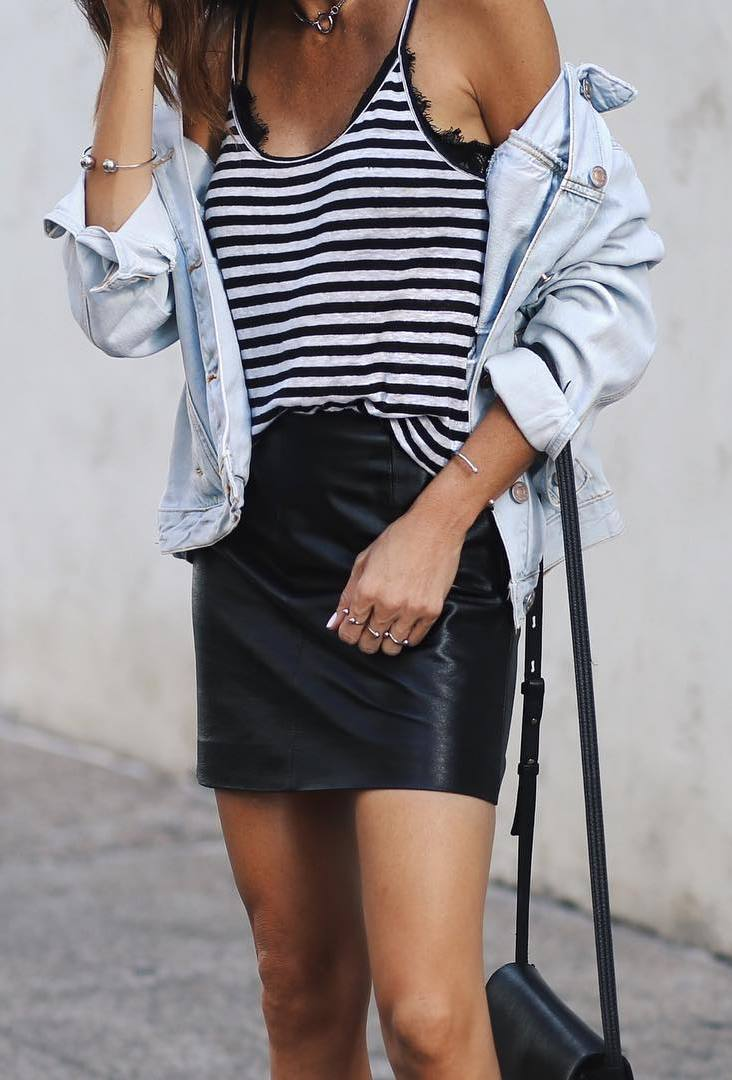 how to wear a stripped top : denim jacket + bag + leather skirt