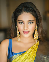Nidhhi Agerwal New Saree Photo Shoot HeyAndhra