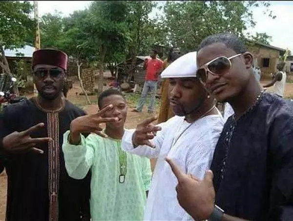 Entertainment: Furious Fans Dig Up Pictures Of When Banky W Picked Wizkid From The Slum, and brought him up (See Photos)