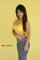 Cute Telugu Actress Shunaya Solanki High Definition Spicy Pos in Yellow Top and Skirt  0088.JPG
