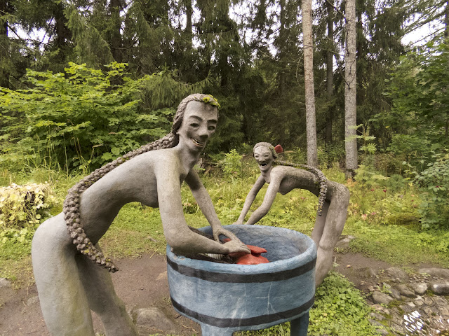 Cave men washing clothes at Parikkala Sculpture Park, a roadside attraction in Finland
