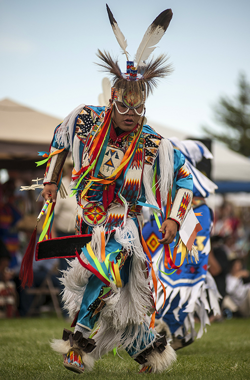 Image of a Native American pow wow dancer in colorful traditional dress.