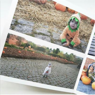pagina de álbum digital , compuesta por dos fotos de halloween niño disfrazado de calabaza, y de fantasma con fondo paisaje con calabazas en ambas fotos