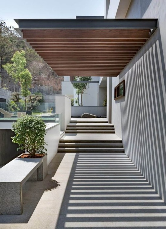 tangga modern minimalis untuk entrance dan landsekap rumah