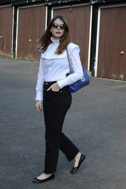 White frill shirt from Archive by Alexa Chung for Marks and Spencers, Black flat ballet pumps from Topshop, Black vintage Levis 501 Jeans, Blue Mulberry Lily bag.