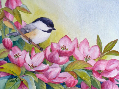 A chickadee alights on a crabapple tree