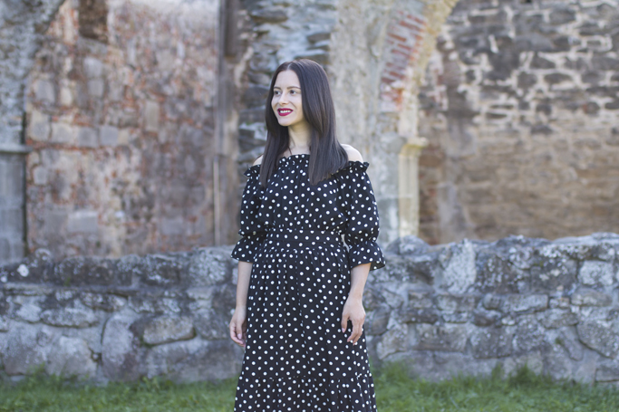 black dress and white polka dots