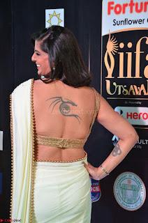 Varalakshmi in Cream Saree Sleeveless Backless Deep Neck Choli at IIFA Utsavam Awards March 2017