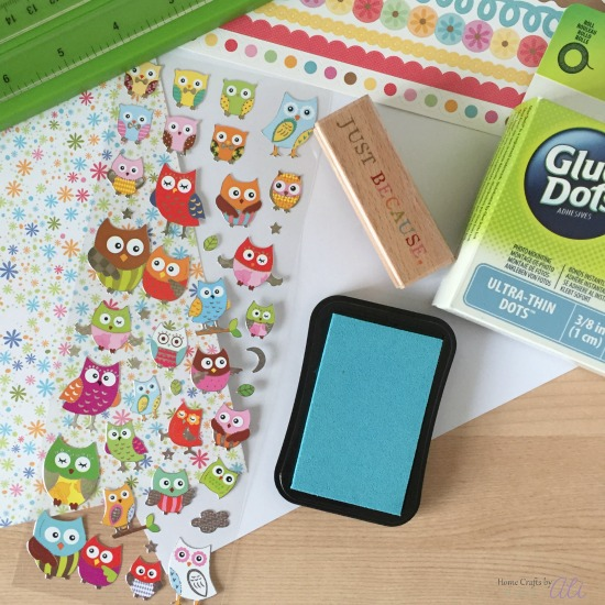 Fun craft stickers, colorful decorative paper, and glue dots to make a card