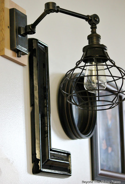 wall sconce, oil rubbed bronze, edison bulb, gallery wall, Robert Abbey, vintage, light cage,http://bec4-beyondthepicketfence.blogspot.com/2015/10/gallery-wall-with-awesome-light-sconces.html
