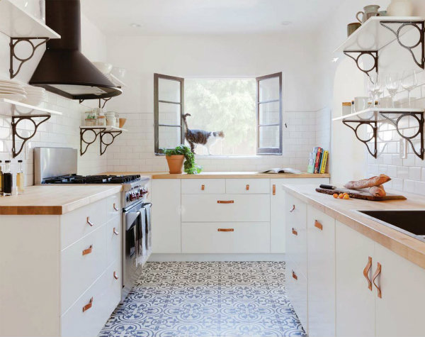 A Small All White Beach House Kitchen Gets A Burst Of Fun By Bringing In  Patterned Cement Tiles On The Floor And Shelf Brackets That Echo The Swirly  Floor ...