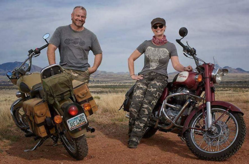 Two people and their motorcycles.