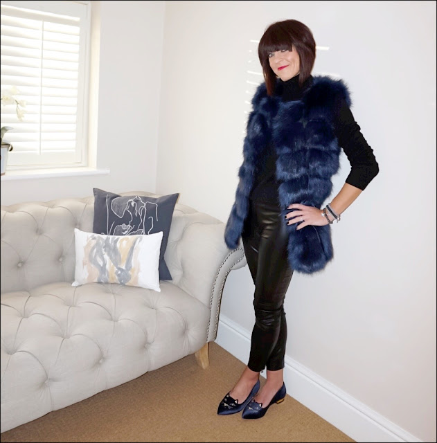 My Midlife Fashion, faux fur gilet, meme london friendship bracelets, marks and spencer pure cashmere polo neck jumper, french connection faux leather trousers, charlotte olympia mid century kitty slippers