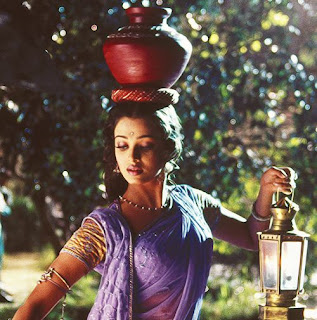 Aishwarya Rai In Saree With Pitcher And Lantern