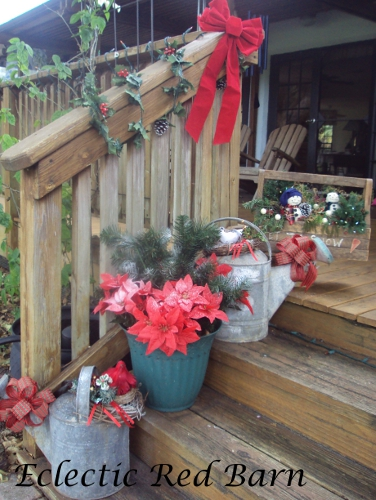 Decorated Steps with Vintage Watering Cans and Poinsettias
