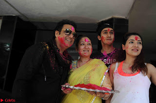 Govinda celeting Holi with His family wife daughter 007.JPG