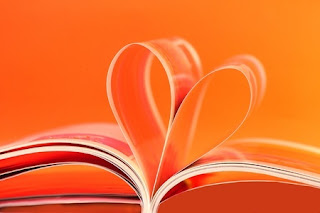 Pages of an open book curled into the spine to make a heart