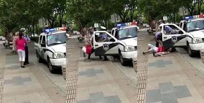 polisi china banting perempuan gendong anak
