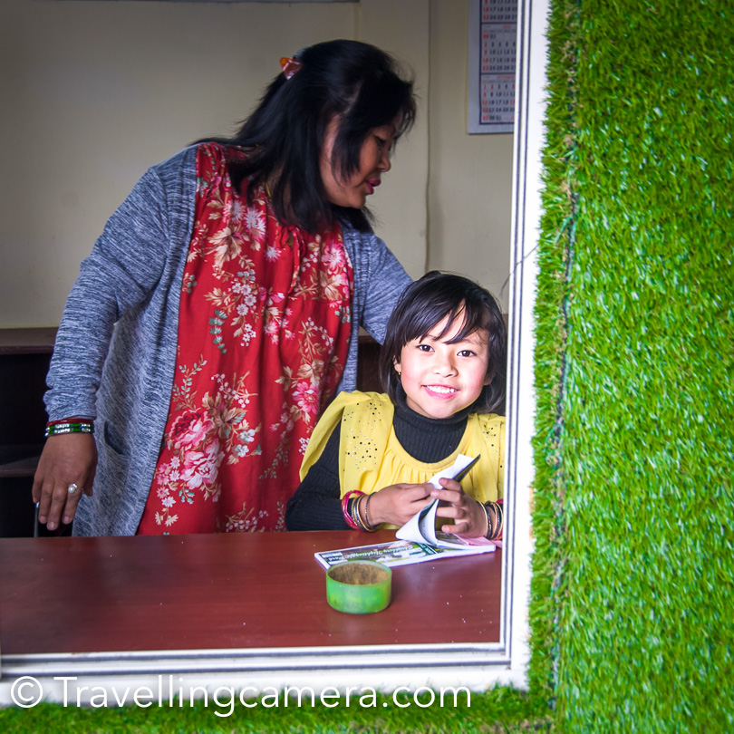 Here is the cute girl who gave us the tickets to enter Shruberry Park at Darjeeling. She was there at the counter with her mom and was enjoying the process of taking money and giving the tickets to visitors.